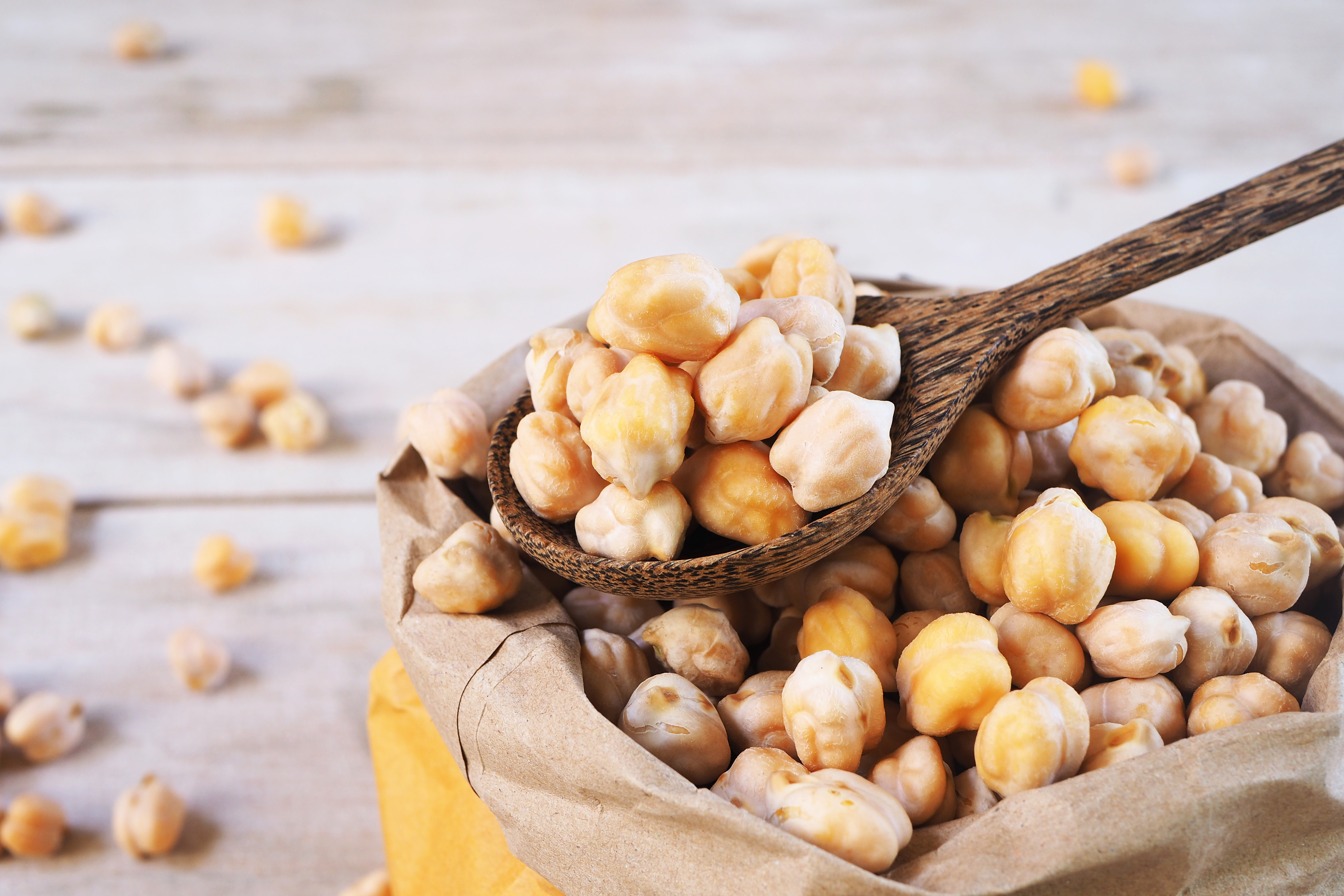 A-wooden-spoon-of-dried-chickpeas-on-a-chickpea-bag_shutterstock_449291566.jpg